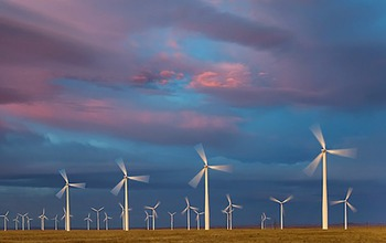 Rows of turbines at sunset on the prairies at the Ponnequin Wind Facility in Colorado.