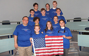 Photo of team members holding the U.S. flag