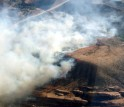 aerial view of canyon covered by clouds of smoke