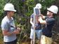 Researchers installing stormwater sensors