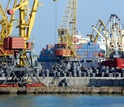 Image of cranes and conatiners in a port