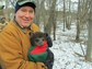 James Hewlett holds a black bear cub