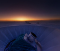 The sun sets behind BICEP2 and the South Pole Telescope.