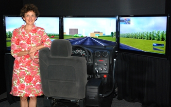 Photo of Flaura Winston in the Center for Child Injury Prevention Studies virtual simulator room.
