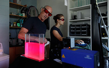 Jack Costello and a colleague conduct research on siphonophores in the laboratory.