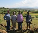 Seifu Tilahun stands with community farmers and a USAID representative in Ethiopia