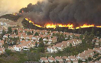 Approaching wildfire threatens a subdivision