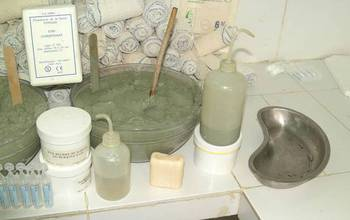 French green clays in pots, bottles and soap on a counter