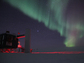 The IceCube Neutrino Observatory  at Amundsen-Scott South Pole Station with aurora australis