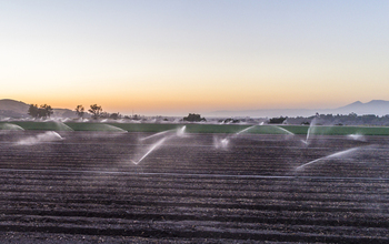 An agricultural field in California being irrigated.