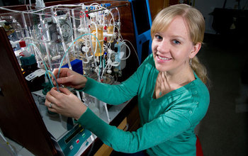 oceanographer Katie Shamberger with instruments that measure carbon dioxide in seawater.