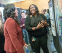 A Garden State LSAMP scholar explains her research poster to a visiting NSF program officer.