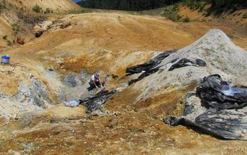 Open pit near Crater Lake, Oregon, showing blue clay sampled by scientist Keith Morrison.