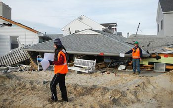 Researchers assess storm damage after Hurricane Sandy.