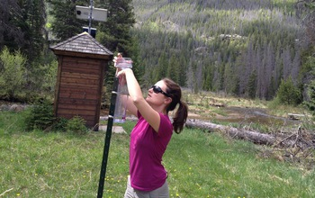 Researcher collecting precipitation samples