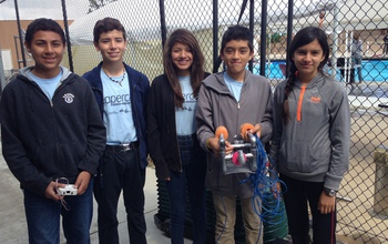 Children in a Sea Perch team with a remotely operated vehicle.