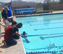 Sea Perch team members next to a pool where they test their remote operated vehicles