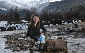 Researcher with water sample taken from the Big Thompson River