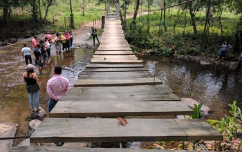 a wooden bridge over water