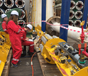 Shipboard scientists test valves and data loggers