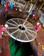 Photo of the opening in the ship's floor that allows access to seafloor sediments.