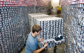 Photo of a researcher in a core repository where cores are stored.