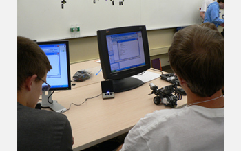 Photo of visually impaired students working through a computing challenge at ImagineIT.