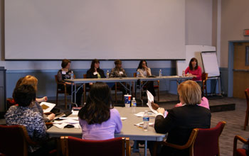 Photo of ACTiVATE alumnae sharing experiences with a new class.
