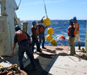 Photo of mooring operations on deck of the research vessel Knorr.