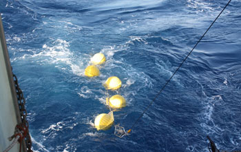 Photo of a current meter and chain of floats deployed as part of several-kilometers-long mooring.