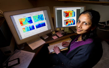 Oceanographer Amala Mahadevan with a model showing the role of eddies in the bloom.