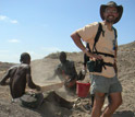 Photo of field crew sieving for fossils with geologist Jonathan Wynn.
