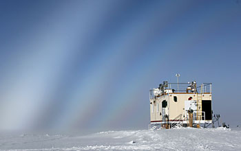 Photo of sky with fog bows over summit station in greenland