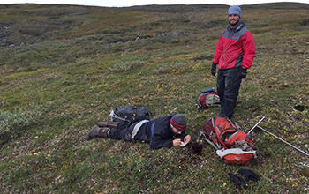 Michael O'Connor (left) and Stephen Ferencz sampling permafrost soil