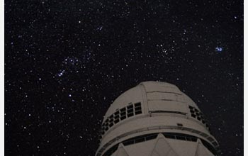 Photo of the Orion constellation as seen over the Mayall 4-meter Telescope on Kitt Peak.