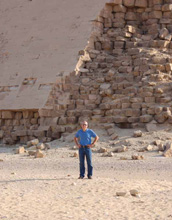 Photo of a man in front of one of the pyramids