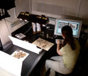 Photo of a researcher entering specimen images into a computer.