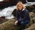 Scientist Emily Carrington among blue mussels on southern Maine's rocky shores.