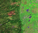Map showing Boulder Creek, and tributary Fourmile Creek, with red burn scar from a wildfire.