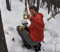 Researcher T. Joe Mills samples winter snows in the Boulder Creek watershed.