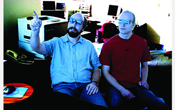 Photo of 2 researchers wearing 3-D glasses.