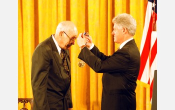 John Cahn receives the Medal of Science from President Clinton.
