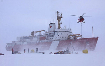 crew members deploy equipment onto the ice from a Canadian icebreaker