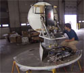 Scientist in a hangar works on a new kind of weather radar