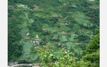 Photo of rural China showing agricultural development and fragmented forests.