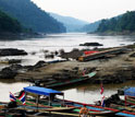 Photo of boats and people on the Salween river forming the boundary between Burma and Thailand.