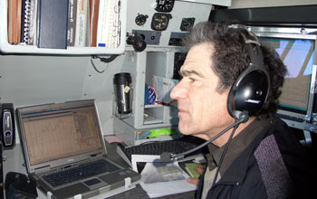 Photo of lead researcher Andrew Heymsfield monitoring clouds from an aircraft.