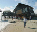 Photo showing damaged beachfront house in Rodanthe, N.C. caused by Hurricane Isabel.