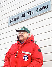 Rev. John Coleman in front of sign, Chapel Of The Snows.