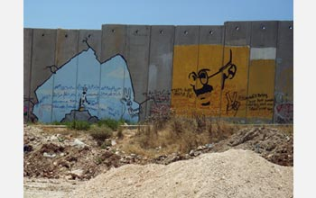 A drawing of Mahatma Gandhi on the wall separating the West Bank from Israel.
